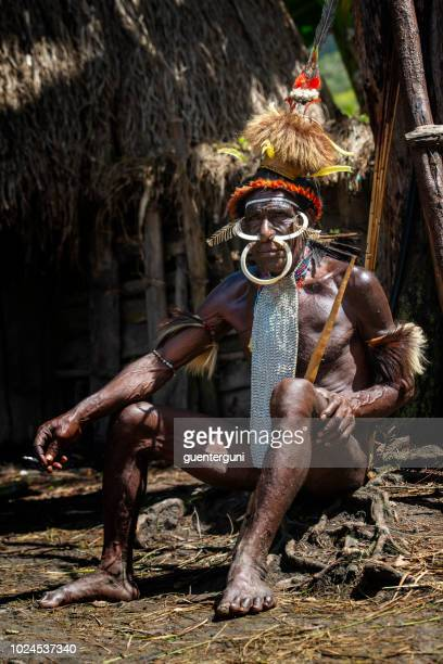 man of the dani tribe in traditional clothing, west-papua - penile sheath stock photos and pictures