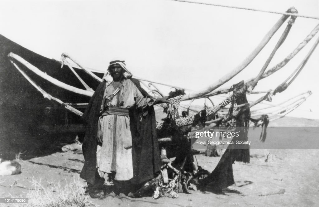 A man of the Huwaytat in front of a woman's camel litter, or hawadaj : News Photo