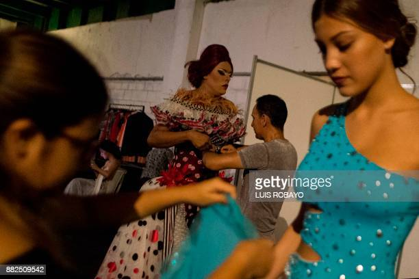A man of the LGBTI community gets ready backstage before participating in the Walkway Inclusion fashion show in Cali Colombia on November 29 2017...