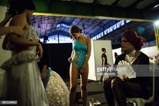 TOPSHOT A man of the LGBTI community gets ready backstage before participating in the Walkway Inclusion fashion show in Cali Colombia on November 29...