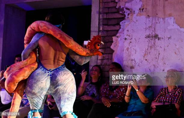 A man of the LGBTI community model a creation by Colombian designer Diego Morales during the Walkway Inclusion fashion show in Cali Colombia on...