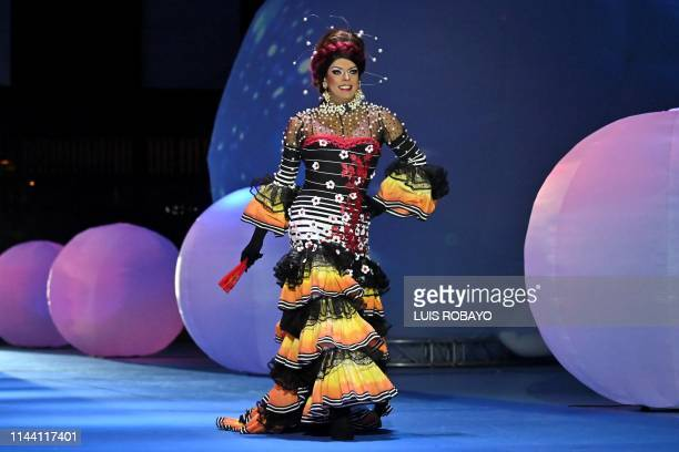 A man of the LGBTI community models a creation by Colombian designer Diego Morales during the Walkway Inclusion fashion show in Cali Colombia on May...