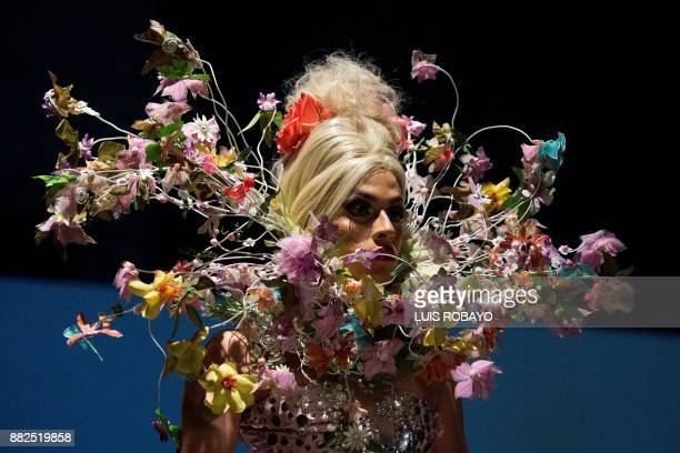 A man of the LGBTI community models a creation by Colombian designer Diego Morales during the Walkway Inclusion fashion show in Cali Colombia on...