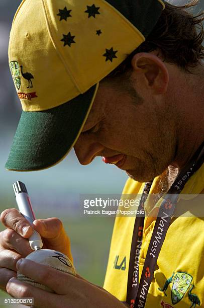 Man of the Match Adam Gilchrist of Australia signs the match ball after the NatWest Challenge One Day International between England and Australia at...