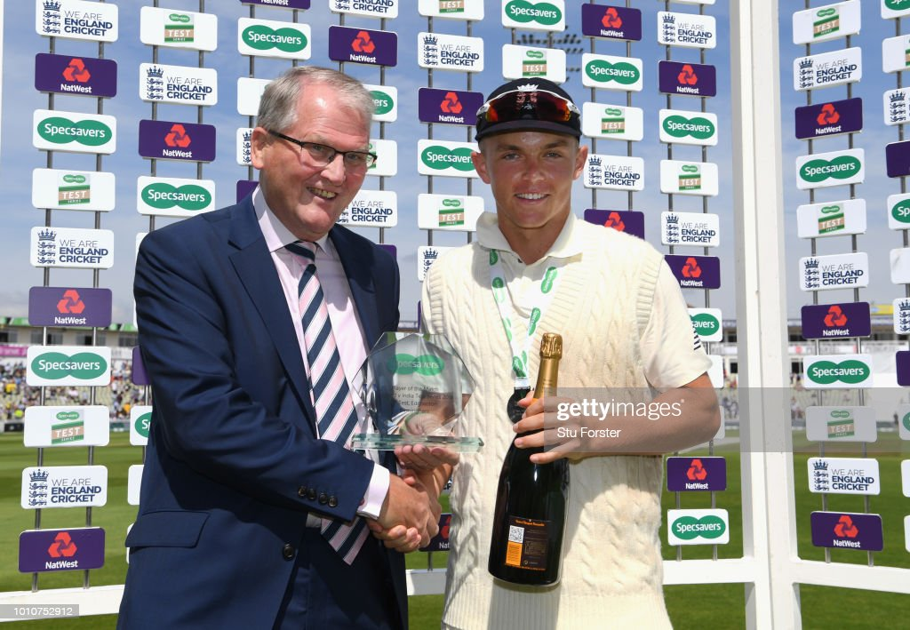 Man of the Match and England player Sam Curran with his trophy presented by Norman Gascoigne during day 4 of the First Specsavers Test Match between England and India at Edgbaston on August 4, 2018 in Birmingham, England.