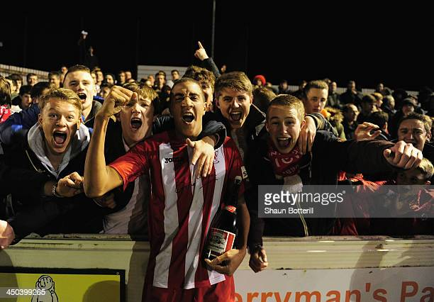 man of the match and goal scorer Glenn Walker of Brackley Town celebrates with fans after the FA Cup First Round Replay match between Brackley Town...
