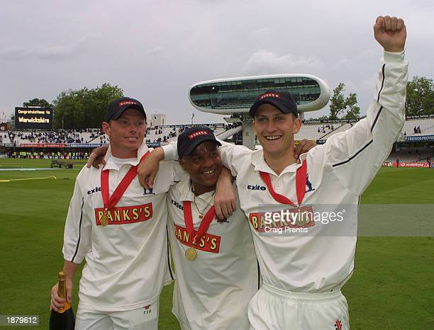 Man of the Match Ian Bell [Left] Keith Piper [Center] and Jim Troughton [Right] of Warwickshire celebrate after beating Essex in the Benson Hedges...