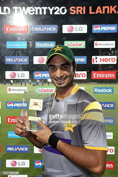 Man of the Match in the Group D match Imran Nazir of Pakistan poses with his Man of the Match award between Pakistan and Bangladesh at Pallekele...