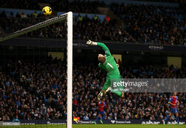Man of the Match Joe Hart Goalkeeper of Manchester City tips a shot at goal over the cross bar during the Barclays Premier League match between...
