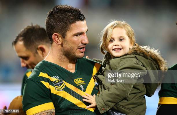 Man of the match Matt Gillett of Australia is pictured with his daughter during the ANZAC Test match between the Australian Kangaroos and the New...