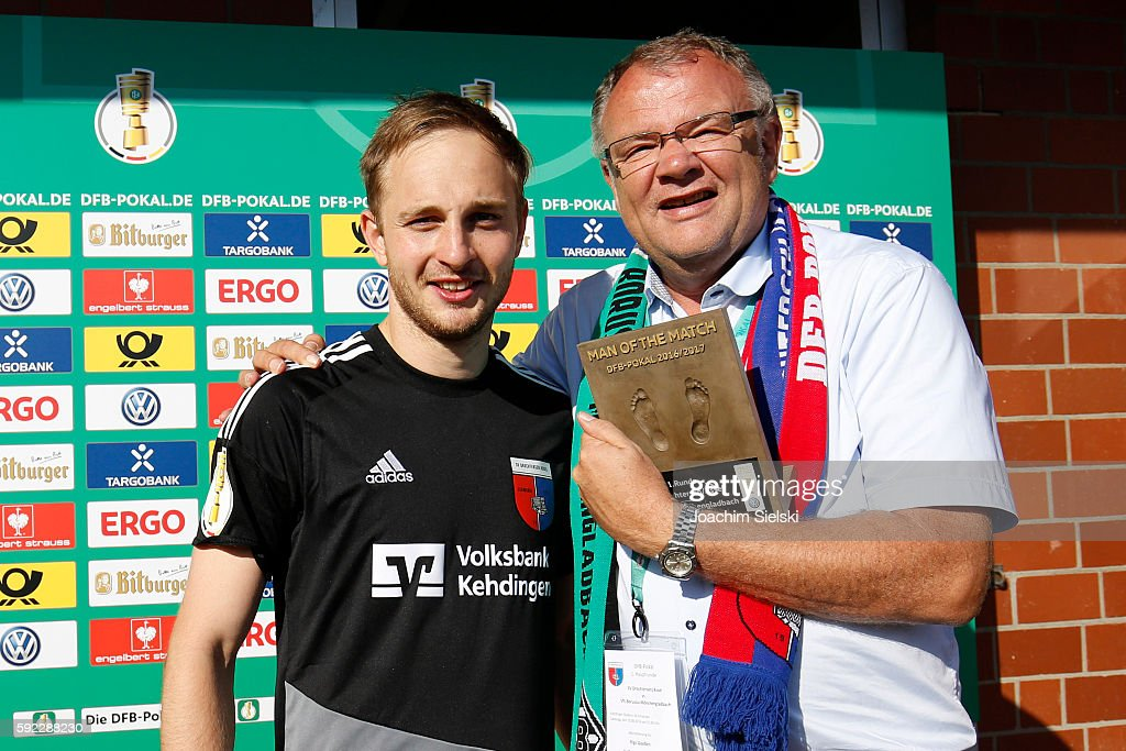 Man of the Match Patrick Siefkes together with Rigo Goossen of Drochtersen after the DFB Cup match between SV Drochtersen/Assel and Borussia Moenchengladbach at Kehdinger Stadion on August 20, 2016 in Drochtersen, Germany.