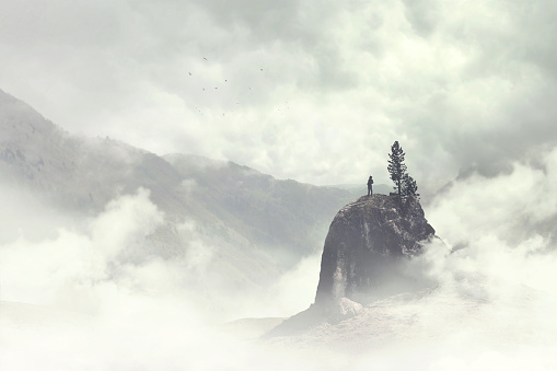 man of the top of the mountain in the fog 898700222