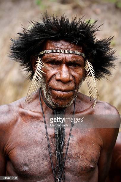 A man of the traditional Dani tribe from Lembah Baliem poses for a photographer on October 10 2009 in Wamena West Papua Indonesia The primitive tribe...