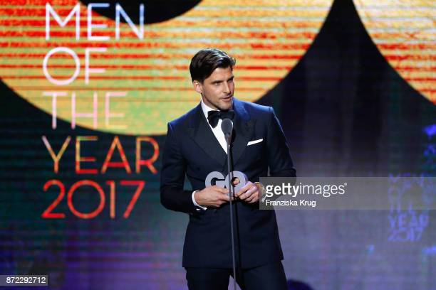 Man of the year Johannes Huebl is seen on stage at the GQ Men of the year Award 2017 show at Komische Oper on November 9 2017 in Berlin Germany