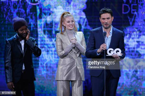 Man of the year Simon Verhoeven Palina Rojinski and Eric Kabongo are seen on stage at the GQ Men of the year Award 2017 show at Komische Oper on...