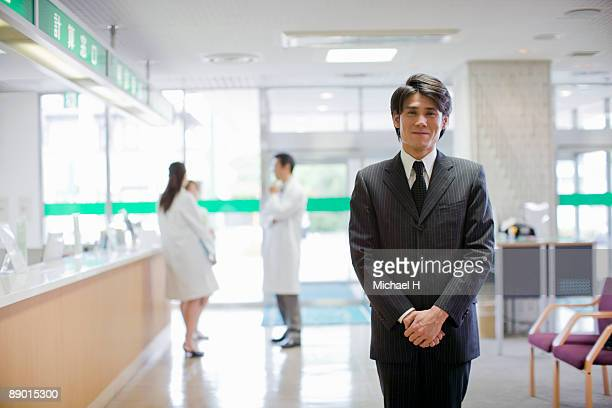 Man of wearing a suit in hospital