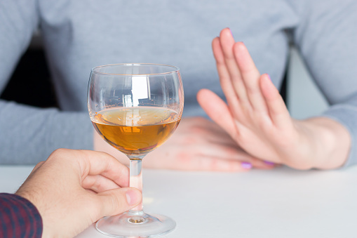 man offer alcohol but woman refuses 1139731439