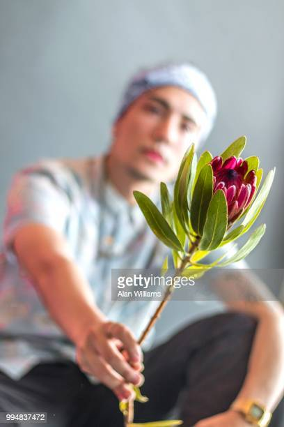 Man offering flower