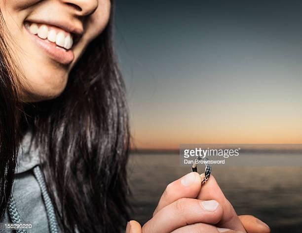 Man offering girlfriend ring outdoors