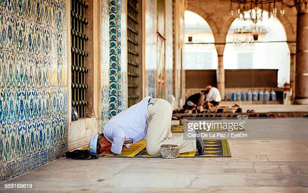 man offering namaz at mosque - mosque stock pictures, royalty-free photos & images