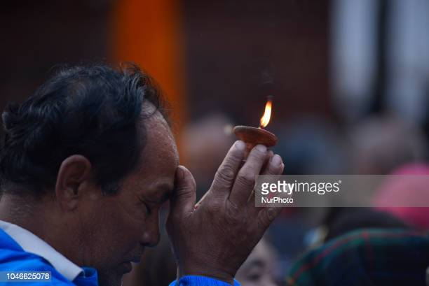 A man offering oil lamps in the Kaal Bhairab Statue at Basantapur Durbar Square Kathmandu Nepal on Saturday October 06 2018