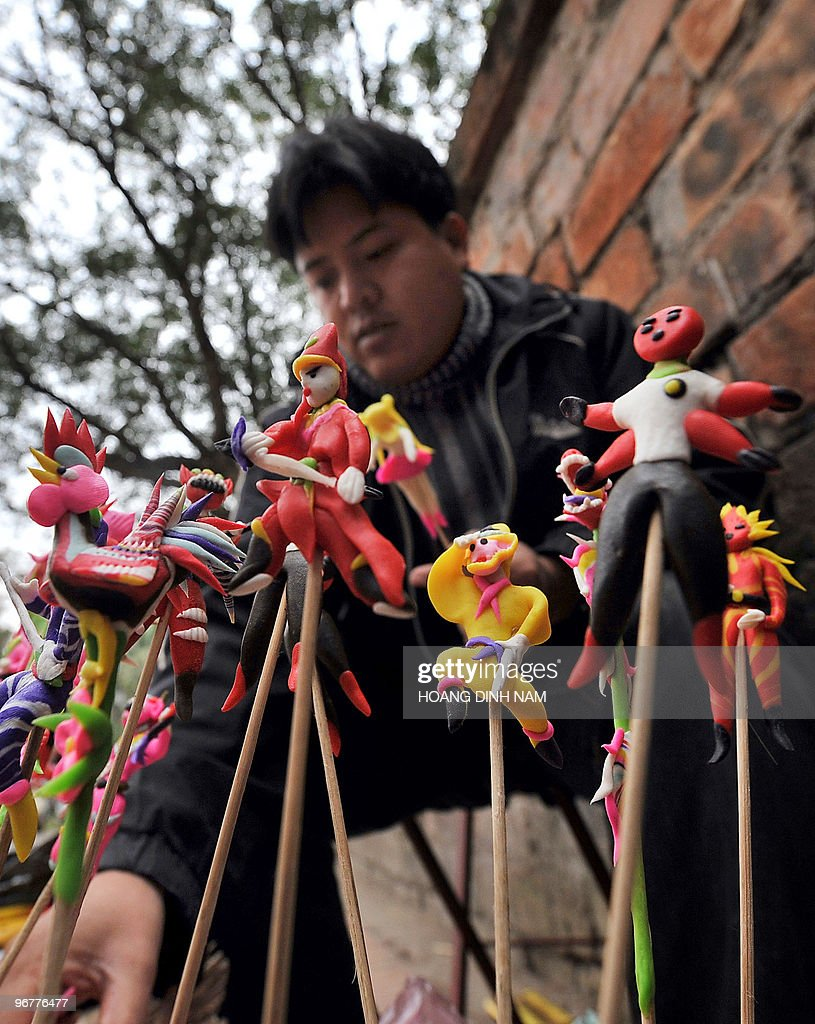 A man offers colourful miniature figures for sale to children