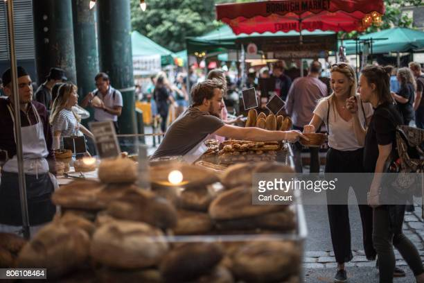 A man offers sample chocolates to women browsing his stall in Borough Market on July 3 2017 in London England On 3 June 2017 Islamist terrorists...
