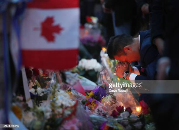 TORONTO ON APRIL 24 A man offers up a prayer at a candle light vigil is held at Olive Square near Yonge and Finch Streets for the 10 people that were...