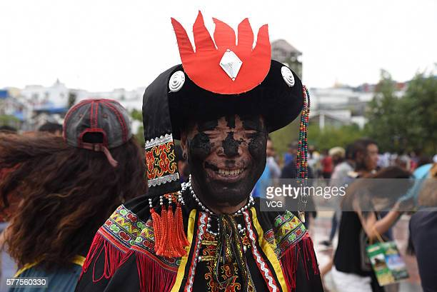 Man ofYi ethnic group is daubed rice ash on face during the Face Painting Festival in Puzhehei Resort of Qiubei County on July 18, 2016 in Wenshan...
