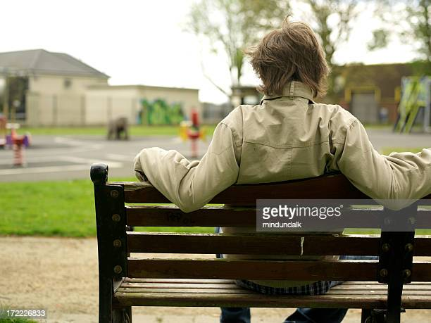 man on a bench at the park