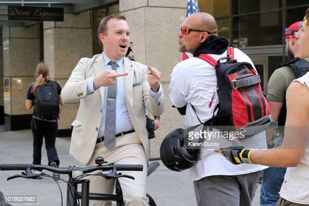 A man on a bicycle confronts protesters marching in a Patriot Prayer rally called Liberty or Death Rally Against Left Wing Violence on August 18 2018...