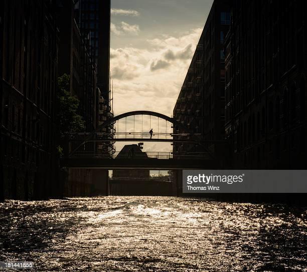 Man on a bridge in Speicherstadt