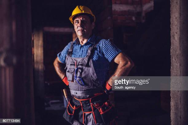 man on a construction site - plumbing stock pictures, royalty-free photos & images