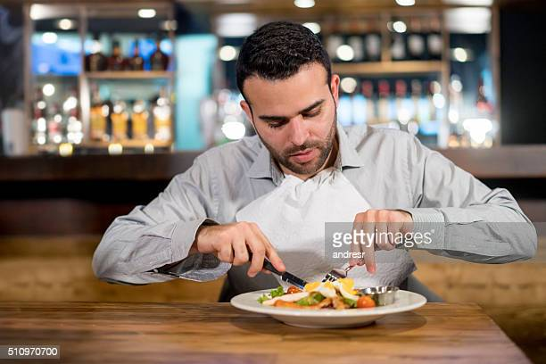 Man on a diet eating at a restaurant