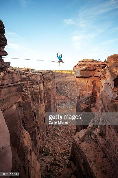 Man on a high line over a canyon in Moab.