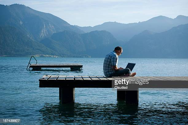 man on a jetty working outdoor - correspondence stock pictures, royalty-free photos & images