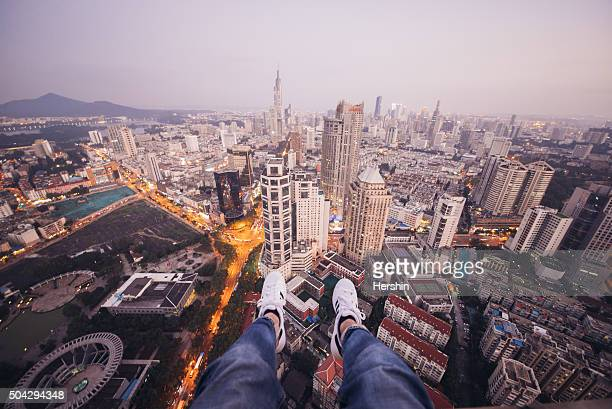 Man on a Ledge Looking Down-Nanjing skyline