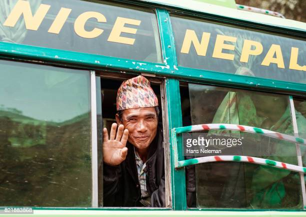 man on a local bus window, nepal - nepal stock pictures, royalty-free photos & images