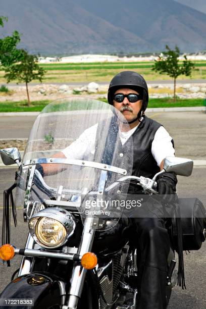 Man on a Motorcycle.