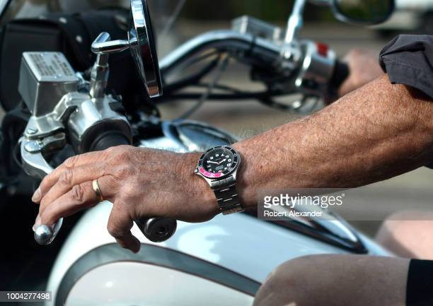 A man on a motorcycle wearing a Wenger Swiss Military Watch pauses at a red light in Santa Fe New Mexico