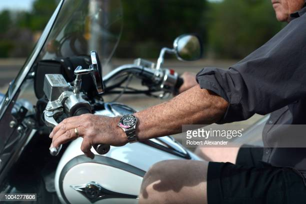 Man on a motorcycle wearing a Wenger Swiss Military Watch pauses at a red light in Santa Fe, New Mexico.