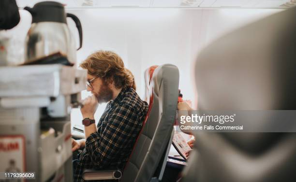 man on a plane - airplane stock pictures, royalty-free photos & images