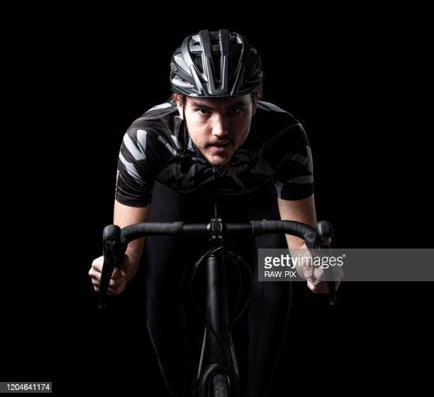 man on a roadbike - divisa sportiva foto e immagini stock