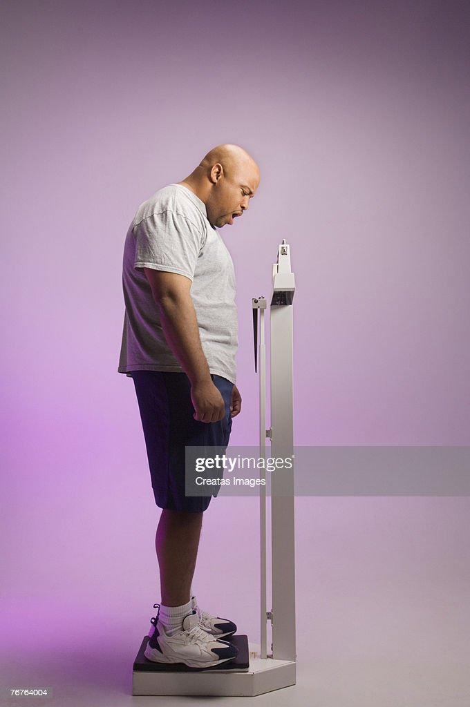 Man on a scale : Stock Photo