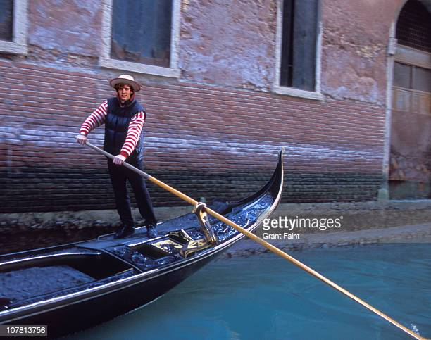 man on a  steering gondola - gondola traditional boat stock pictures, royalty-free photos & images