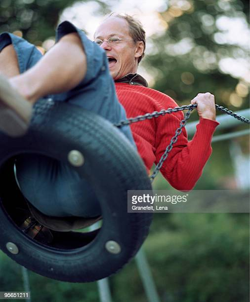 a man on a swing, sweden. - lena spoof stock pictures, royalty-free photos & images