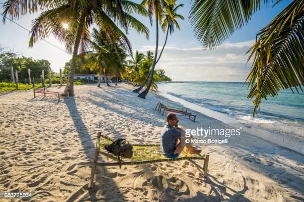 Man on a tropical beach. Saona Island, Dominican Republic.