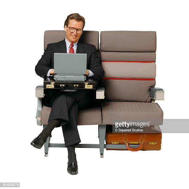 Man on Airplane with Laptop