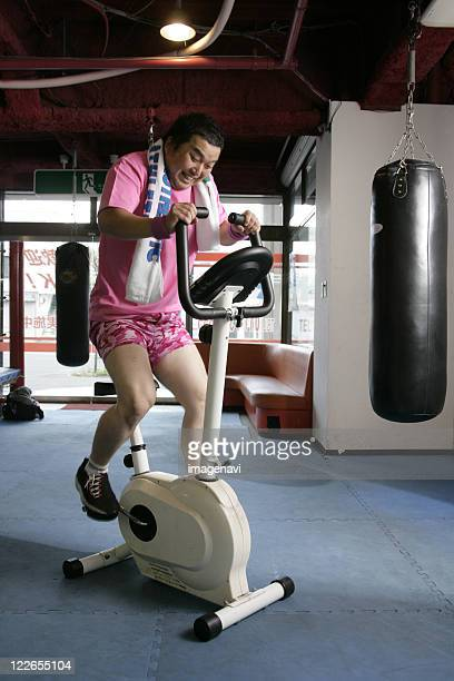 A man on an exercise bike