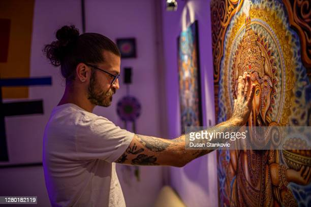 man on art exhibition - art show stock pictures, royalty-free photos & images